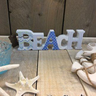 tekst Beach van hout